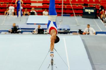 sports gymnastics athlete gymnast exercises on horizontal bar