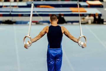 Door stickers Gymnastics sports gymnastics back athlete gymnast exercises on still rings