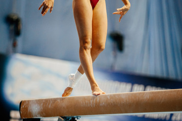 legs women gymnast exercises on balance beam