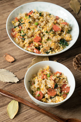 Fried rice with egg and wood grain background