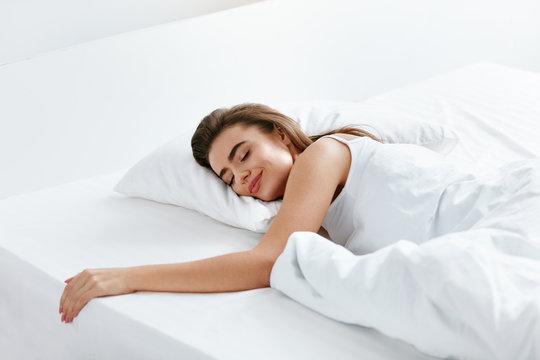 Healthy Sleep. Woman Sleeping On White Bedding