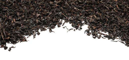 Dry black tea leaves on white background
