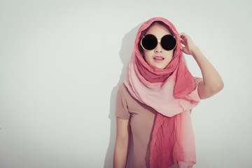 Portrait of young beautiful asian woman posing, retro styling, free from copy space.