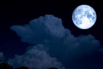 full blue moon and light blue heap cloud on night sky