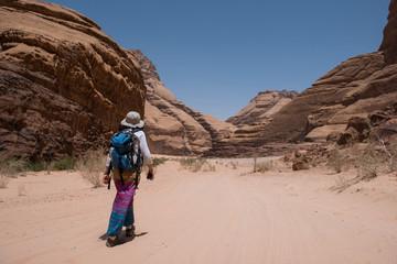 Woman trekking in the desert