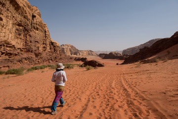 Woman trekking in the desert