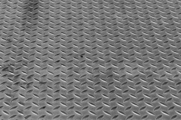 Metallstruktur für den Hintergrund, Diamantplatte. Aluminium dunkel