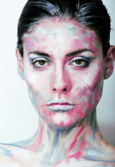 young woman with creative make up like painted oil picture on fa