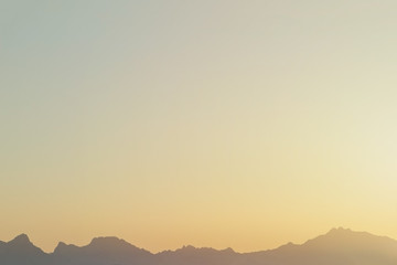 silhouette of red sea mountains on sunset