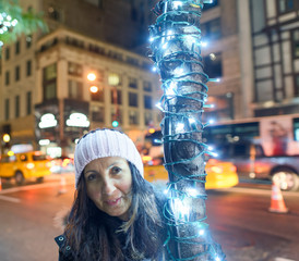 Female tourist happy visiting New York at night
