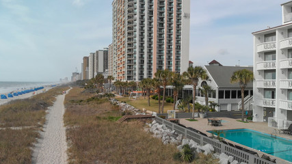 MYRTLE BEACH, SC - APRIL 6, 2018: City buildings and coastline, aerial view. Myrtle Beach is a famous attraction for tourists in South Carolina