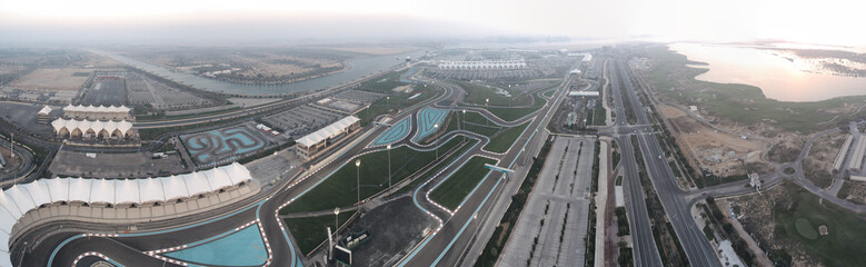 Panoramic aerial view of Abu Dhabi Yas Island sunset skyline