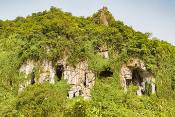 Caves on the mountain side in Vietnam.