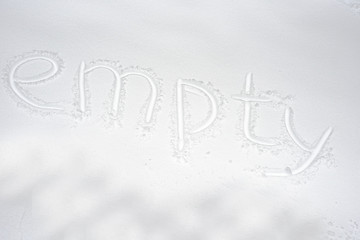 Closeup of word empty writing on white snow background