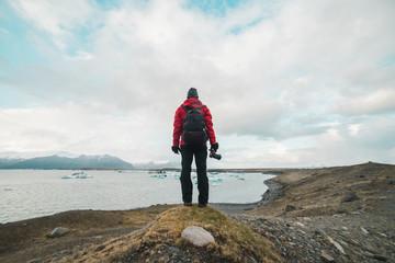Man standing by lake looking away