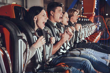 Tuinposter Amusementspark Image of shocked excited four friends