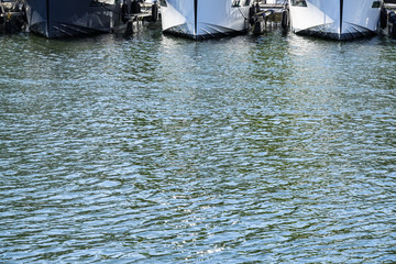 Three yachts that are moored at a dock. Copy space for text.