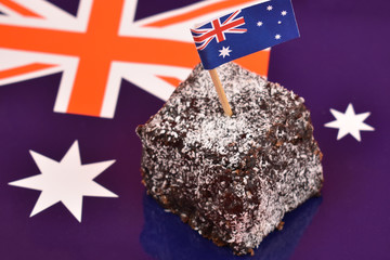 Printed kitchen splashbacks Australia Lamington and Australian flag stock images. Lamington on a national background. Australian sweet delicacy. Important day. Lamington Day background. Australian cake with flag