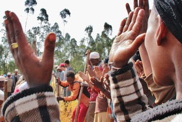 Women clapping in a celebration/feast in Ethiopia