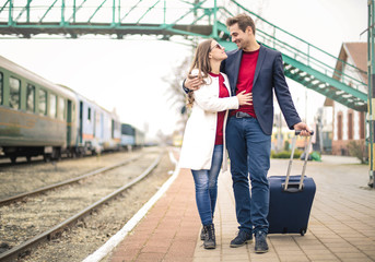 Sweet couple walking together in the railway station