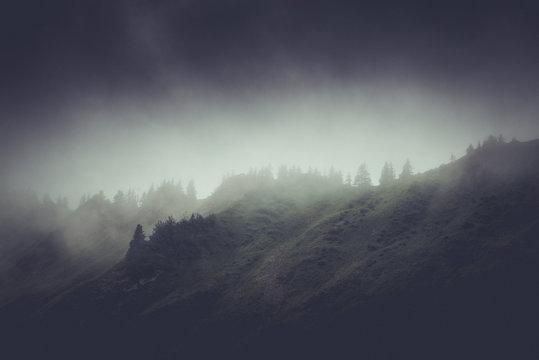Dark moody rainy mountain landscape
