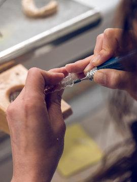 Crop hands making dental tray