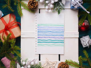 Christmas background with colorful card for message and decorations. Flat lay