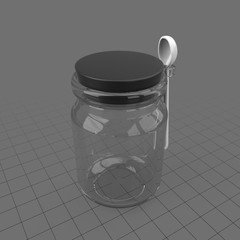 Glass jar with spoon