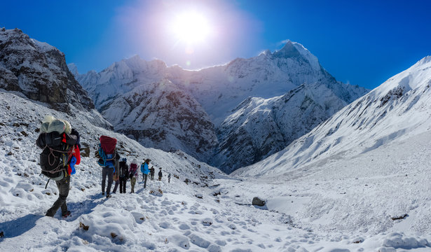 The road in the mountains of Annapurna range with tourist on the way, Nepal Himalayas. travel concept and camping