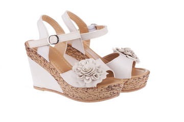 High heels shoes in nude color with flower, wedge platforms sole and ankle strap