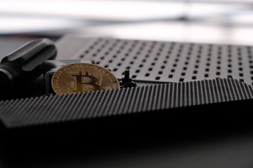 Bitcoin with computer case parts