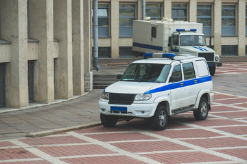 Police vehicle and Prisoner transport vehicle standing near the courthouse in Russia.