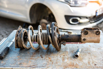 Car suspension repair. Shock absorber.
