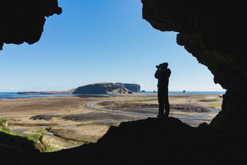 Silhouette of person photographing landscape
