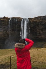 Photographer making pictures of waterfall
