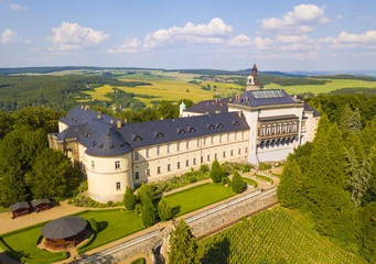 Aerial view of chateau Zbiroh. Romanesque-Gothic castle was founded at the end of the 12th century. Famous tourist attraction in Czech republic, European union.