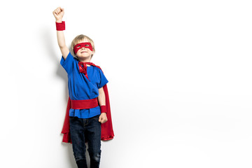 blond Boy superhero in a red cloak isolated on white background