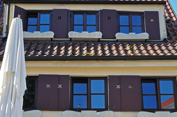 lattice windows and wooden shutters at traditional german house