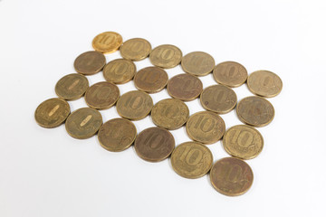 a bunch of Russian coins on a white background of and 10 rubles.