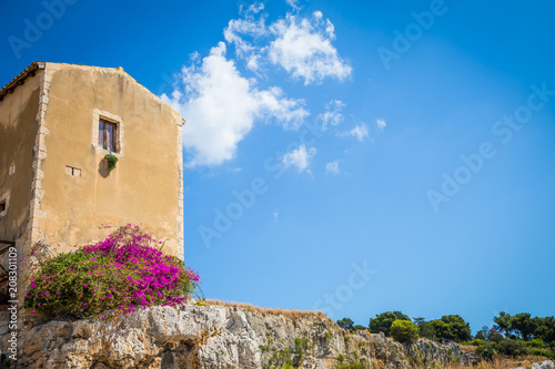 Wall mural Sicily, Italy. Old house with purple flowers in Syracuse.