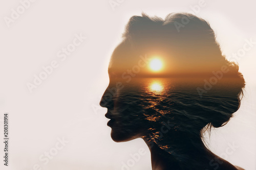 Fototapete Psychology concept. Sunrise and woman silhouette.