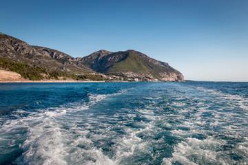 Cala Gonone and wake behind motor boat