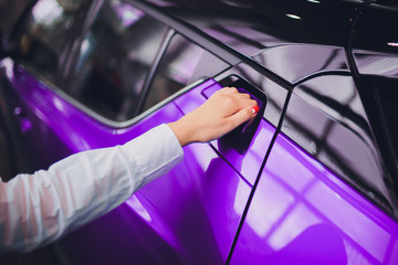 female hand for insert rear door open car purple color. for transport and automotive image