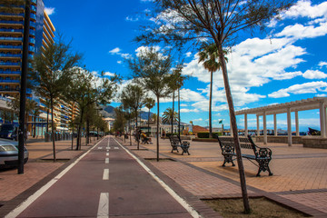 Promenade. A sunny day on the beach of Fuengirola. Malaga province, Andalusia, Spain. Picture taken – 5 june 2018.