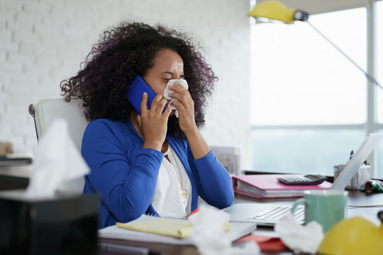 Sick Black Woman Working from Home Sneezing For Cold
