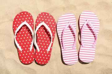 Beach flip flop on sand background