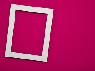 Empty frame on pink wall with copy space. Minimal concept.