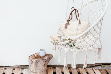 Summer hygge concept with hammock chair in the garden