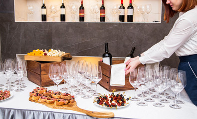 the waiter serves the wine and cheese tasting area
