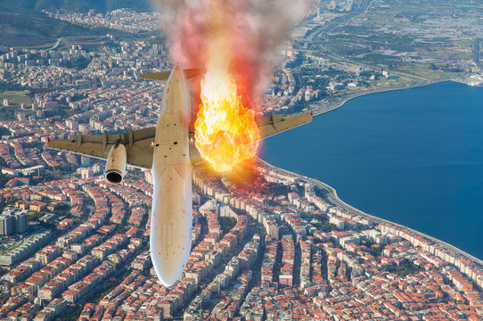 Jet carrier and engine on fire over the city